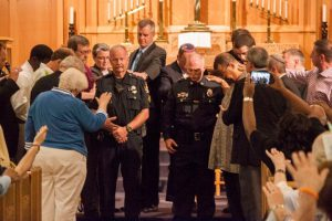 police prayer close up