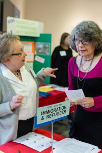 Mary M at Imm and refugee table